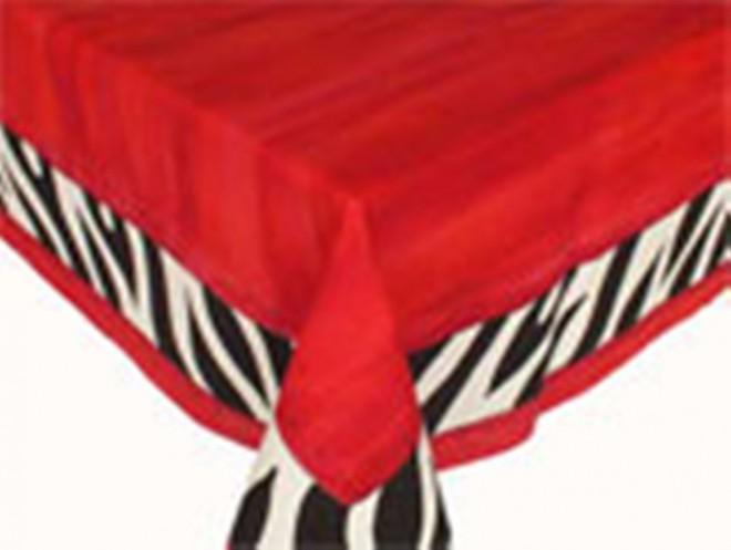 RedZebraTischdecke. Ein farbenfrohes Rot gepart mit dem klassischen Schwarz-weissen Zebramuster. Ihre Tischgäste werden begeistert sein.
